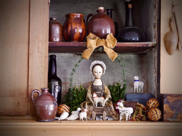 My name is Peggy Flavin, and I live in an old house by the sea. I am a doll maker, antique collector and old house lover!