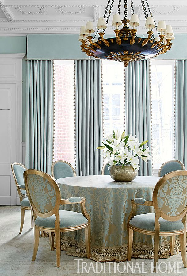 The dining room teases with a color that is not quite blue, not quite green on an oversize silk damask that skirts the table and backs the chairs. - Photo: Werner Straube / Design: Gail Plechaty