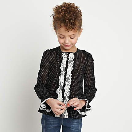 A cute Mini Me with a curly updo. Check out the nails! Lol.