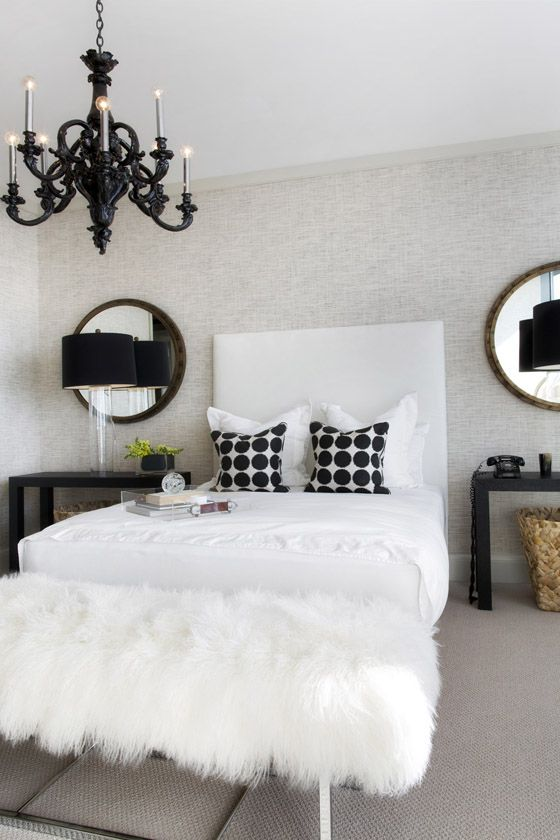 Black & white, black chandelier, obsessed with the white fur bench!! It's almost perfect ... I would do diamond tufted headboard and mirrored nightstands.