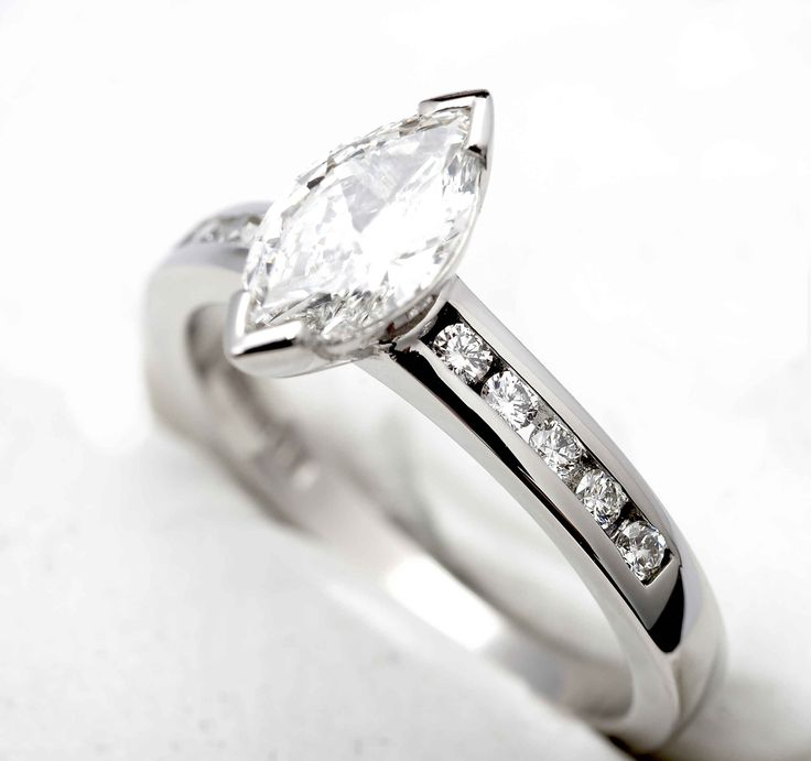 Palladium engagement ring with Marquis centre Diamond and brilliant cut Diamonds on the shoulders.