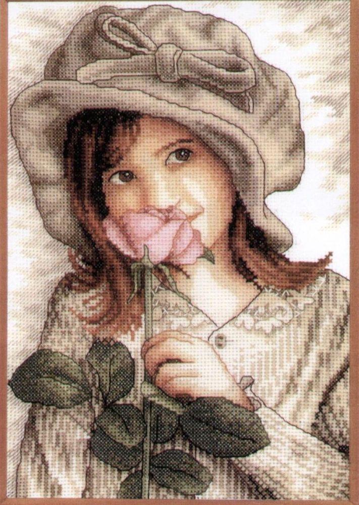 niña con rosa