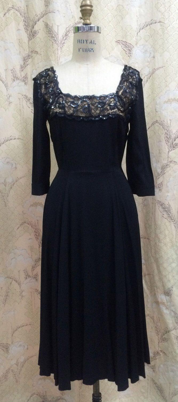 Vintage 1950s Black Lace Cocktail Dress With Sequin Trim/Little Black Dress/Black Lace Wiggle Dress by OnCueVintage on Etsy https://www.etsy.com/listing/259488263/vintage-1950s-black-lace-cocktail-dress