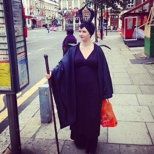 Maleficent, casually waiting for a bus and holding a Sainsbury's bag.   The 30 Best Costumes From The London Film & Comic Con