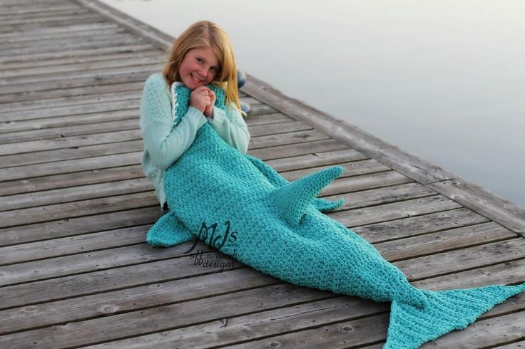 This is a PDF crochet pattern for a soft & Cozy Dolphin Blanket! Perfect to snuggle up with on the couch for all the dolphin lovers out there!! My pattern includes newborn to adult sizes so everyone in your family can enjoy one!! The blanket is designed to cocoon around the legs and feet to keep you tucked in and warm. The blanket is made using an 11.5mm (P) hook and a 9mm (M) hook made with Bernat Blanket yarn. I recommend purchasing the 300g balls and you will need 1-3 balls depending o...