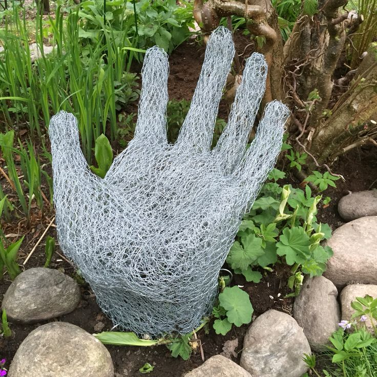 Large hand made of chicken wire