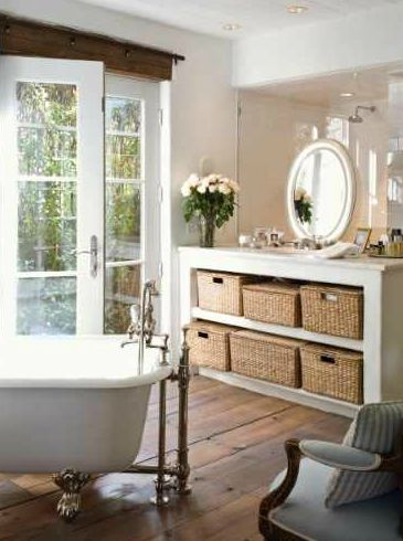 Open storage vanity on glass shower wall; Boxwood Interiors