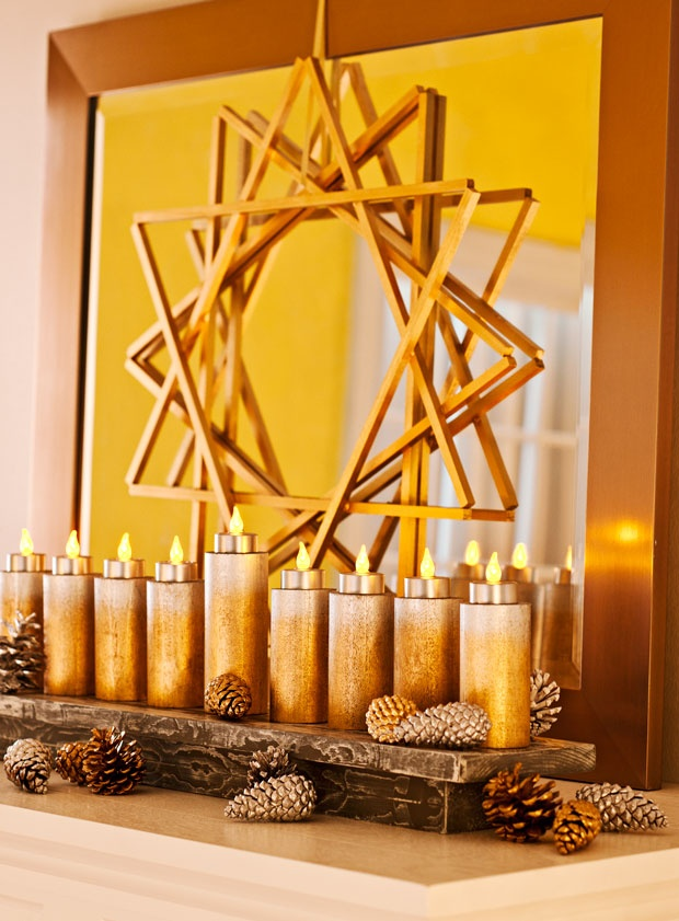 I loved this star - there was another shot of it later on in the Lowes Creative Ideas magazine showing a pair of these painted blue hanging in front of a window.  Also like the Menorah idea.
