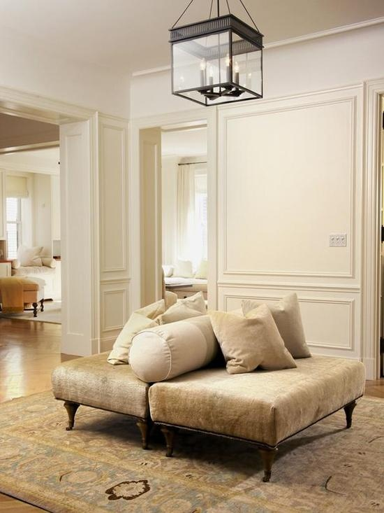 Foyer Sitting Area : Neutral ottomans create a foyer sitting area apartments