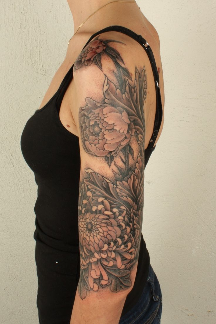 Lovely flower half-sleeve. I love tattoos that wrap around body parts, like the flower over her shoulder.: Grey Tattoo, Acanthus Tattoo, Body Parts, Chrysanthemums Tattoo, Half Sleeve, Peonies Flowers Tattoo, Beautiful Tattoo, Bold Colors, Flowers Sleeve Tattoo