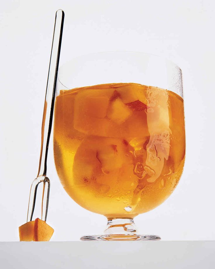 Our Favorite Summer Cocktails | Martha Stewart Living - Cubes of juicy peach and apricots, doused with peach nectar and frozen in an ice tray, punctuate chilled Sauternes, a full-bodied dessert wine from western France. The liquid plumps up the fruit, which descends to the bottom of the glass as the cubes melt.