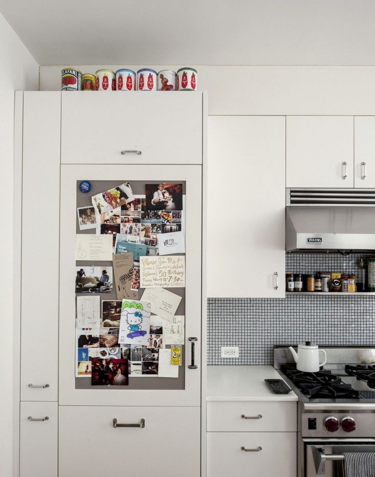 obble Hill duplex kitchen remodel designed by Oliver Freundlich | Remodelista  board on the fridge