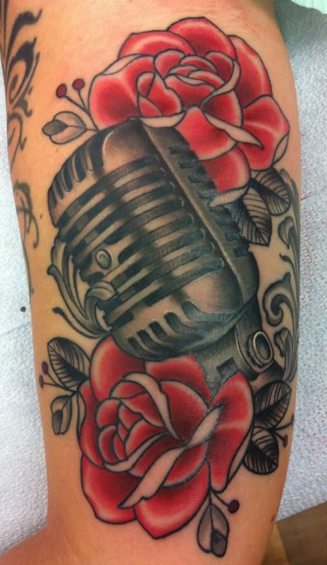 Vintage microphone and rose tattoo. Dan wants a vintage mic in his next tattoo. ^^^ My brother in law, haha. But my music dedication piece is also based around a vintage mic:)