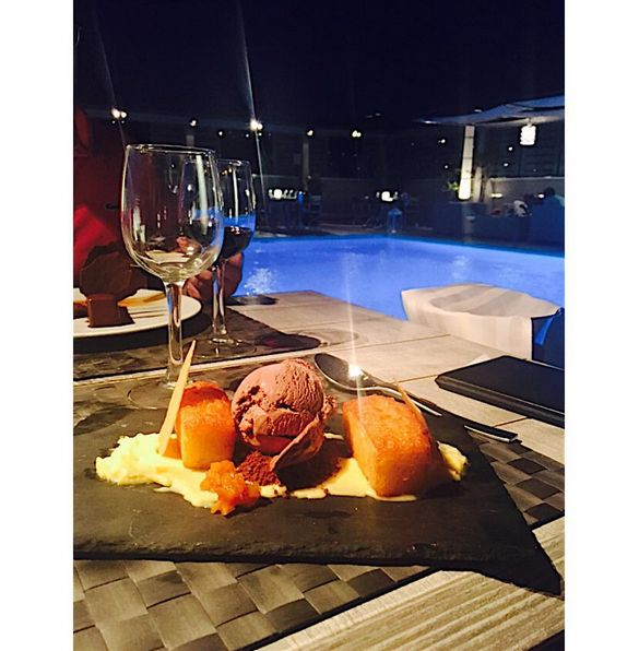 """""""Hidden in the Radisson Blu is a talented chef. A beautiful orange flavoured rivani style cake with chocolate ice cream and orange curd."""" Deliciousness shared by sarahsenderstrom at Instagram on a night at St' Astra Blue Roof Garden!"""
