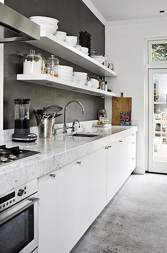 white kitchen with open shelves ad marble countertops