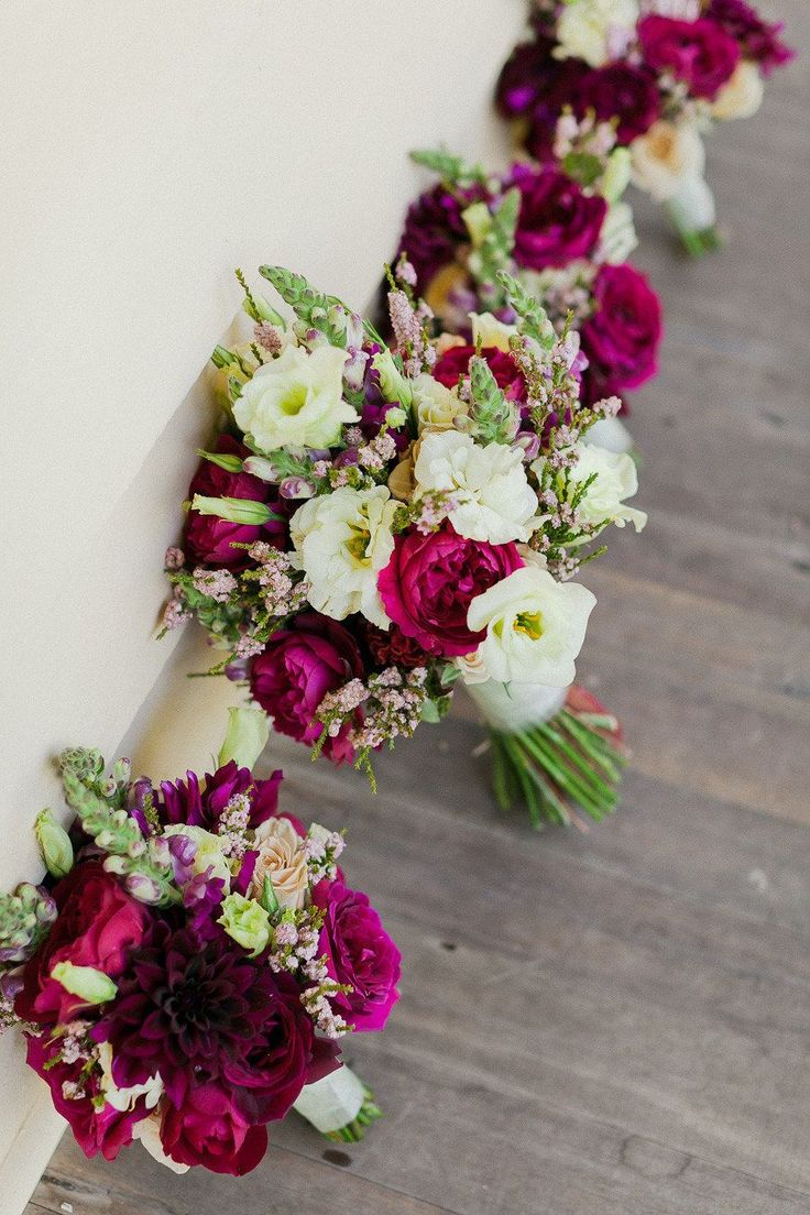 Raspberry & cream wedding bouquet - the raspberry colour really makes these flowers standout