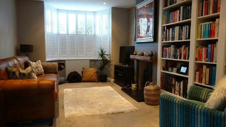 Living room after renovation. Walls Farrow & Ball Purbeck Stone and Mole's Breath. Built in bookcase is an Ikea Billy hack!