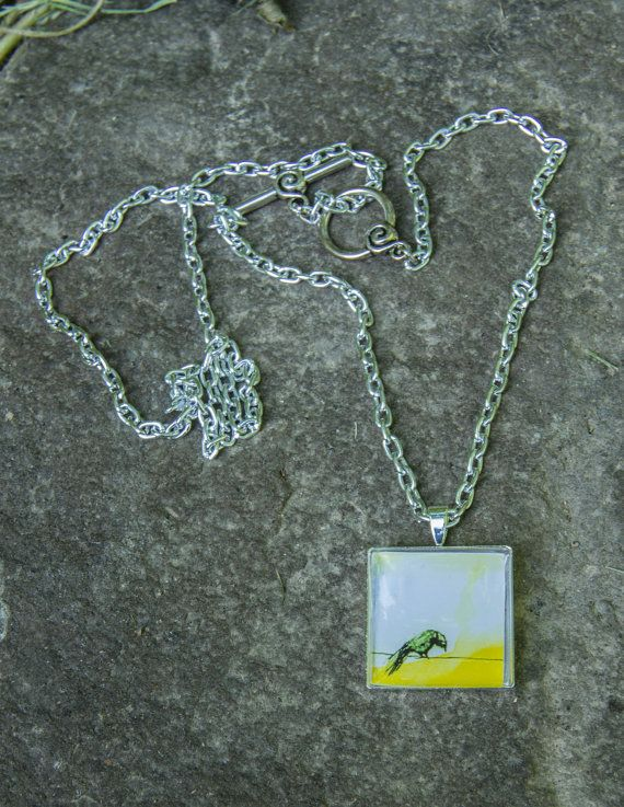 crow with yellow sky necklace by justthingsz on Etsy, $15.00