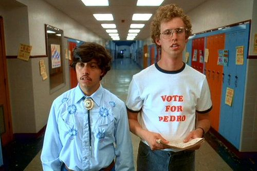 """What to wear for Pedro: A pouffy brown wig, a light blue Western shirt — complete with a bolo necktie — and blue jeans. A mustache is a necessity. What to wear for Napoleon: Boot-cut jeans, a """"Vote For Pedro"""" shirt, glasses, and a blond 'fro. How to act: If you're Pedro, tell everyone to vote for you. If you're Napoleon, avoid eye contact.  Source: Fox Searchlight"""