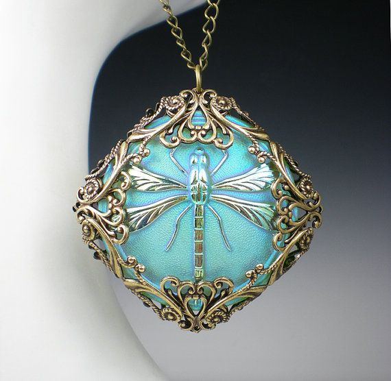 Hey, I found this really awesome Etsy listing at http://www.etsy.com/listing/162204205/dragonfly-necklace-light-turquoise-czech