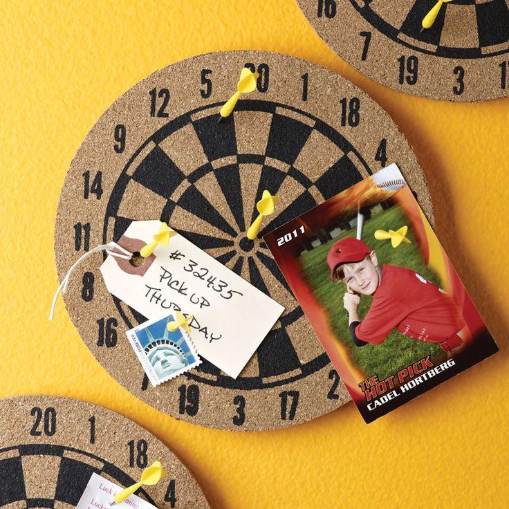 "Bull's Eye Dartboard Organizer   dotandbo.com $14.99 QUALITIES  Dimensions: 6"" Diam. x 1.5"" D  Materials: Cork, metal, plastic, double-sided tape, magnets  Includes: Dartboard, 6 pushpin darts, two mounting options  Installation: Wall mount (double-sided tape and magnets included)"