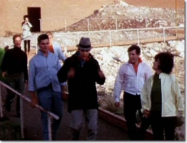Elvis, Priscilla and his entourage visit the Grand Canyon (Priscilla in background filming everyone) 1967