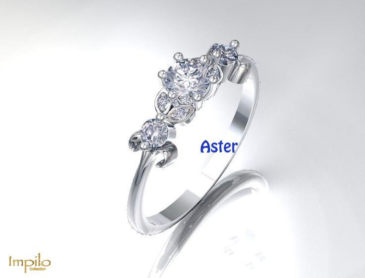 """""""Aster"""" - Beautiful floral design. Round brilliant cut diamond centre stone, with diamonds on each side of the shank."""