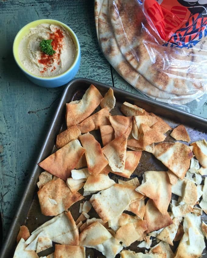 Homemade Baked Pita Chips: extra pita bread and make these Homemade Baked Pita Chips using four ingredients: pita bread, olive oil, garlic and sea salt