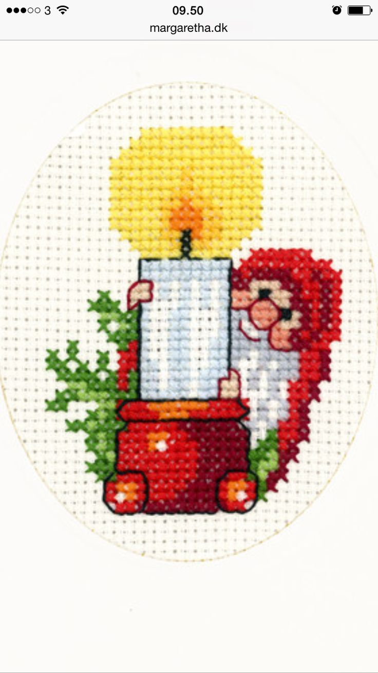 Candle with a gnome cross stitch.