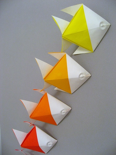 We can't paint or put nails in the wall..so when we decorated our son's nursery, we taped a ton of these origami fish to the wall..colorful, easy and cute!!