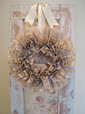 Padgett Hoke: {diy} wreath part two Pages from an old book just folded and pinned to a Styrofoam wreath.