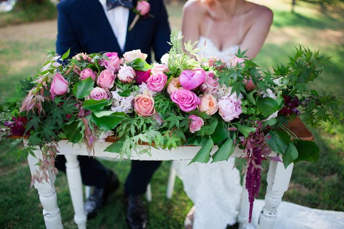 botanical beauty styled shoot   outdoor wedding   inspiration   private property   perth   western australia   furniture hire   wedding ceremony   long table dining   spring   wedding stylist   lace gown   garden wedding   collaboration   signing table   Featured on First Comes Love with images by Amelia Clair Photography