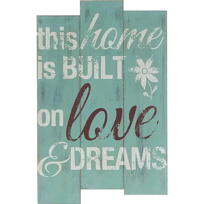 Sfeervolle wanddeco met tekst 'This home is built on love Kwantum