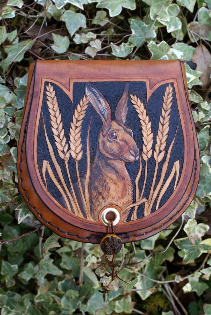 hand carved sporran with hare amidst ears of corn design and Celtic knotwork…