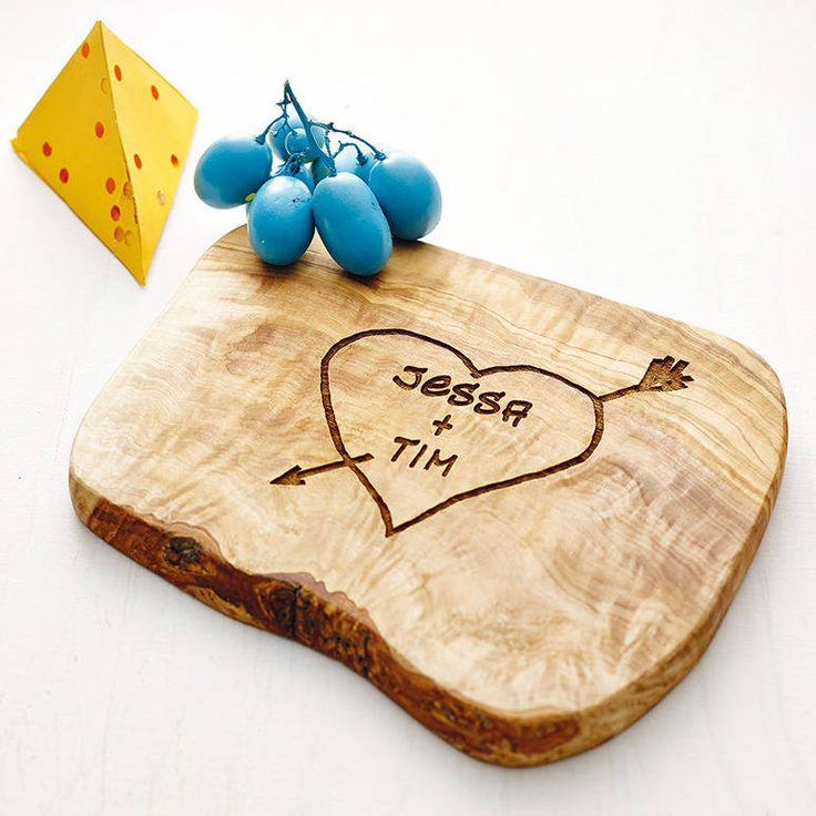 We've combined our most popular rustic chopping/cheese board with one of our most popular personalised designs. Perfect for weddings, anniversaries, engagements, birthdays, valentines and Christmas. Personalised engraving: you can include two names of up to 10 characters each, or try with a top line of initials, RB + TR, and a bottom line with a date of the special occasion. 3 Sizes Available. 20x15x2cm (Main Photo). 30x15x2cm (Thumbnail) and 45x15x2cm.Engraved with a heart and names in the…