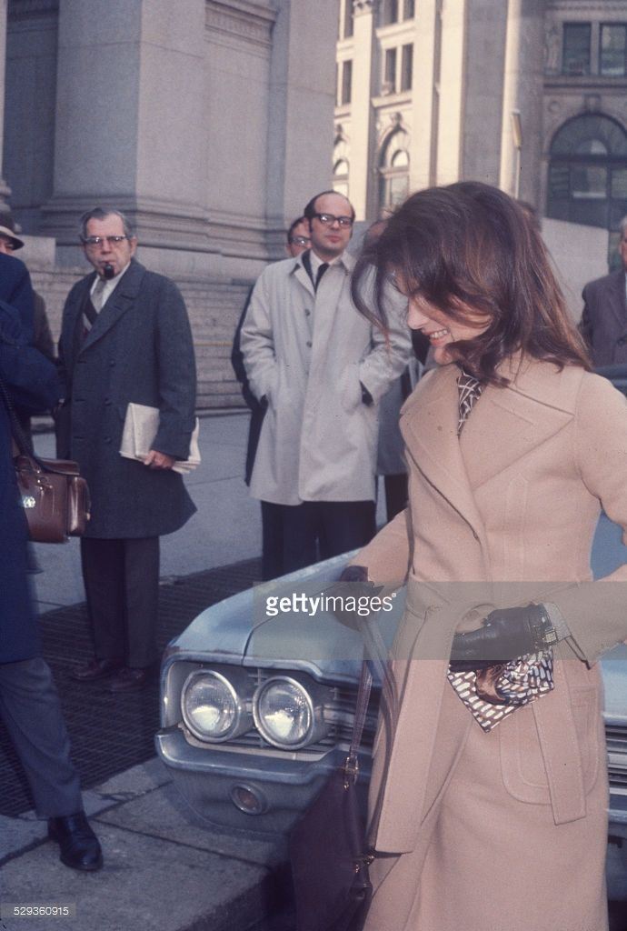 Jacqueline Kennedy Onassis, was on cover of Life Magazine, coming out of courthouse.; circa 1970; New York.