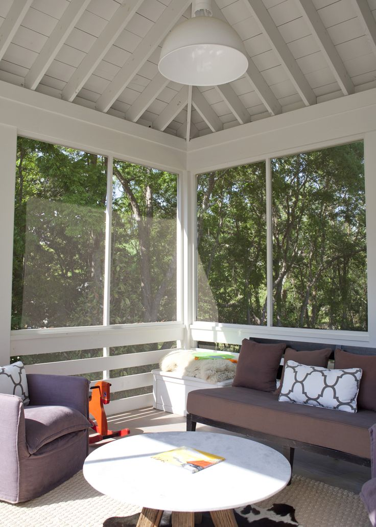 Heather A Wilson, screened in treehouse porch.