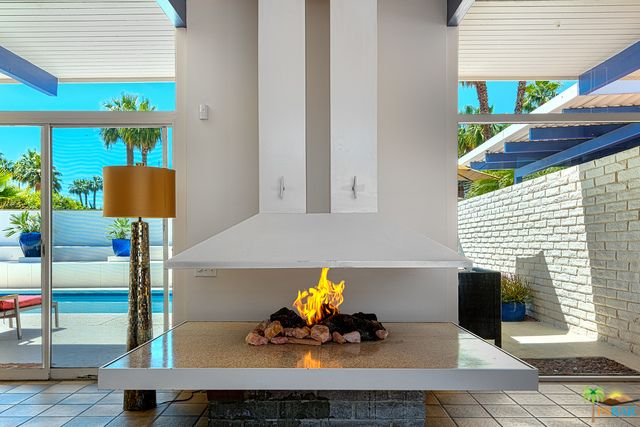 Living Room fireplace of a #RodneyWalkerArchitect residence in the Palm Springs Tennis Club Colonia. Built in 1957 3 Bed 3 Bath 2200+ sq ft residence for sale $1.2M. #3107292310 #KipOConnor.Broker #PlamSpringsLifeRealEstate
