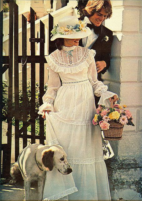 1970's...This is reminiscent of my older sister's wedding dress, with hat and flowers! She was married in 1971