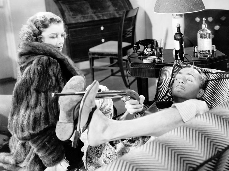 Myrna Loy and William Powell as Nick and Nora Charles of the Thin Man series.