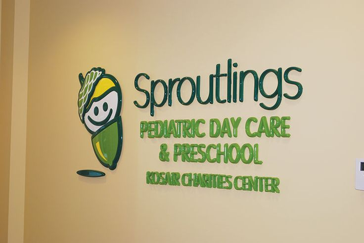 Two green color formed plastic letters with logo. Wall mounted.