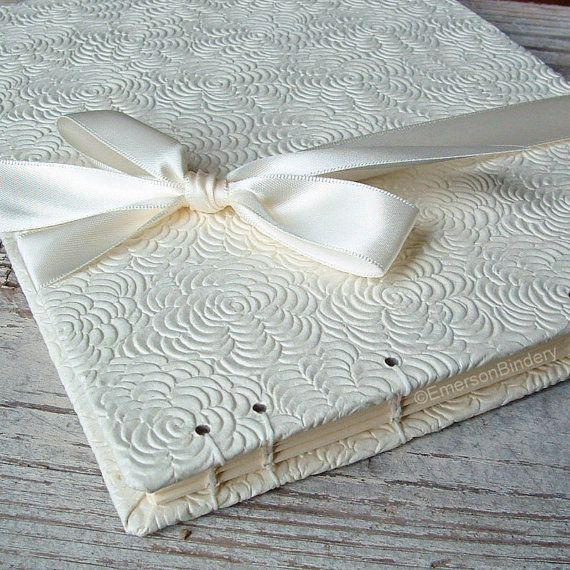 Wedding Guest Book, Vanilla Tea Roses in Ivory No 2, Select a Size, MADE upon ORDER. Gorgeous texture! An embossed floral pattern of rose blossoms in creamy ivory, finished with a vertical satin ribbon in off white. Handmade in North Carolina. Available on Etsy.