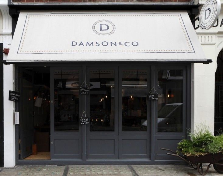 Damson & Co. in Soho, London by Central Design Studio | charcoal trim and folding windows