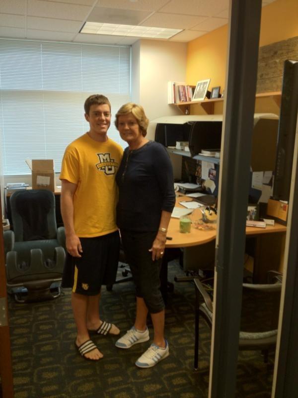 Coach Summitt checking out Tyler Summitt's office at Marquette.