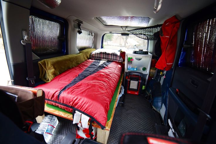 I turned my Honda Element in to a tiny camper. I'm a photographer/snowboard bum so it's awesome to have a mobile space that gets me anywhere I need to go. I needed to have space to do everything inside in case it is too cold or too stormy outside. It's perfect for me, my dog and all my gear! I love it! Check it out and let me know what you think :)