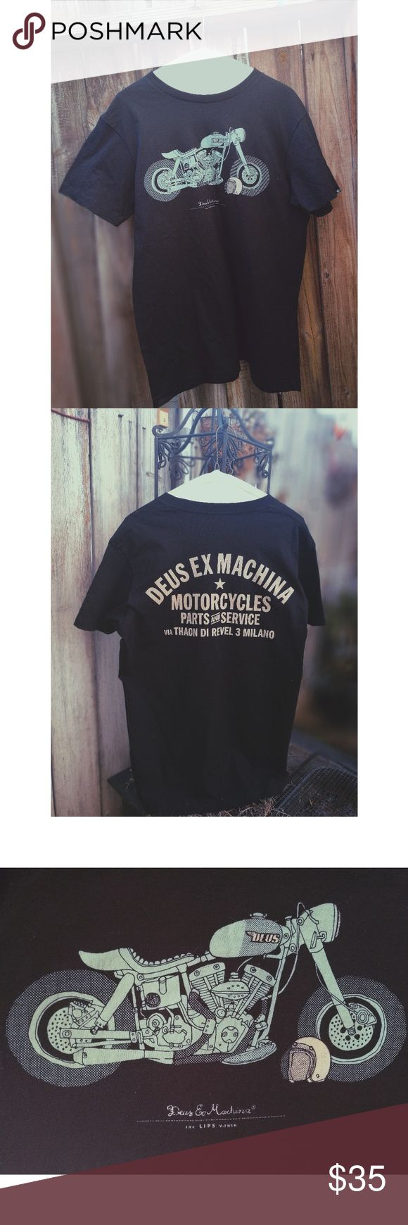 Deus Ex Machina Motorcycle Tshirt This black T-shirt features a pastel teal motorcycle & helmet on the front & writing on the back ( see pic 2) Like new, great condition! Size XL 100% Cotton Deus Ex Machina Shirts Tees - Short Sleeve