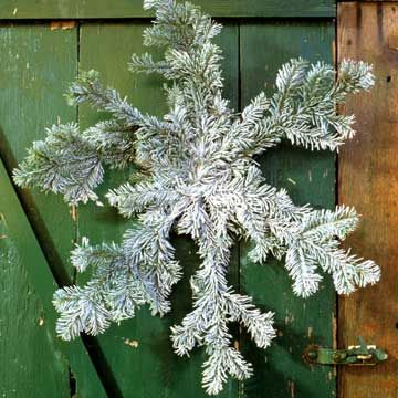 Snowflake wreath using pine bough tips and artificial snow spray!