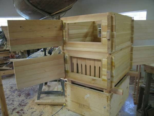 Beehives with observation windows. I really like this design, if nothing else to help teach the little ones about bees.