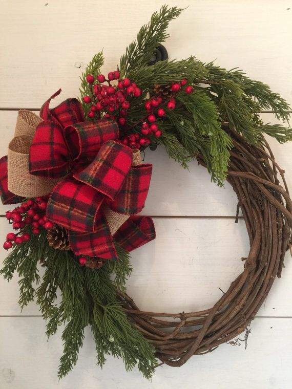 Very fun, rustic and traditional Christmas wreath! Made on an 18 grapevine base with beautiful faux pine and pinecones. I added some red berries & a flannel plaid and burlap bow. *** all measurements are approximate*** Made on an 18-20 grapevine base As with any wreath, some fading may occur over time if placed outdoors or in direct sunlight. Please be sure to check your message/conversation notifications until your order is received. I may have questions about specifics. Thank you so much…