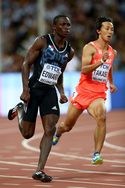 Alonso Edward of Panama (L) and Kei Takase of Japan compete in the Men's 200 metres heats during day four of the 15th IAAF World Athletics Championships Beijing 2015 at Beijing National Stadium on August 25, 2015 in Beijing, China.
